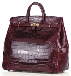 The rare dark red crocodile Hermès 45cm HAC was made in 1972.