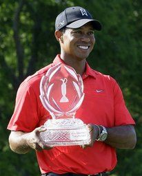 Tiger Woods holds up the trophy after winning the Memorial golf tournament at the Muirfield Village Golf Club in Dublin, Ohio, Sunday, June 3, 2012. Woods finished at 9-under par. (AP Photo/Tony Dejak)