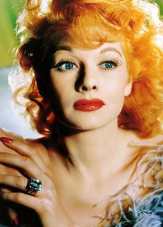 Lucille Ball c. 1943    HH: Before she became the consummate female clown, she was the poster woman for up and coming technicolor with that red hair, blue eyes and alabaster skin.