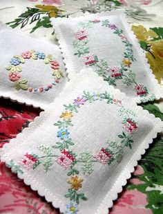 Lavender  Very beautiful and delicate cross stitch.   Other than beautiful and fragrant drawer sachets, these could also  be used to place hot teapots or hot dishes on and the lavender fragrance from  the heat would fill the room.  Great idea for gifts for teachers or for church or social secret pal gifts.