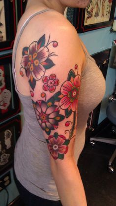 traditional tattoo. Want on my lower stomach but more colors of flowersflowers