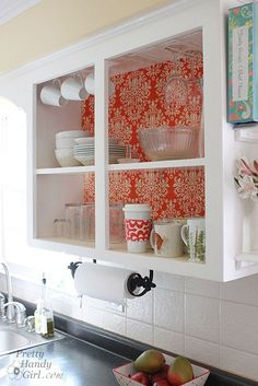 interesting idea. take the doors off of cabinets and line with paper.