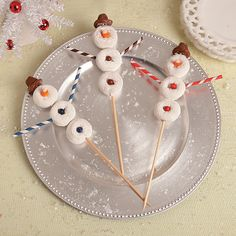 Donut Snowmen--Serve up some sweet skewers this holiday season! A fun way to present your holiday party dessert, these Donut Snowmen on a stick will make your heart melt!
