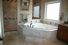Step for corner tub  LOVE THIS IDEA different tile on the wall but otherwise I love it