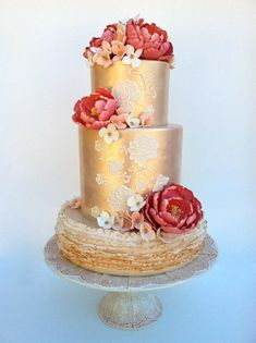 Pink and gold ruffle and floral wedding cake