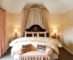 Wow great bed crown and monogramed headboard