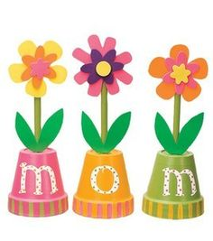 """These colorful flowers could be created using paper cups.  Having photographs of students in the middle of their """"Mother's Day Flower Pots"""" would give this project a nice finishing touch."""