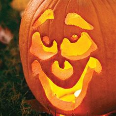 Glowing Halloween Pumpkins | Give a jack-o'-lantern extra glow with some vegetable oil or petroleum jelly. Apply a small amount to the outer skin with a paper towel after you have finished carving. | SouthernLiving.com