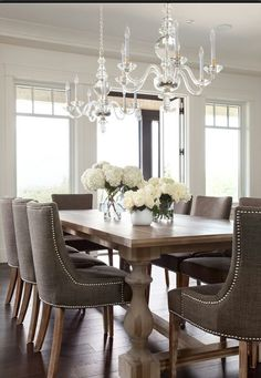 Dining room - chair, table, and the double chandelier - love it