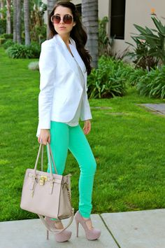 Minty green skinny jeans paired with nude pumps. CUTE