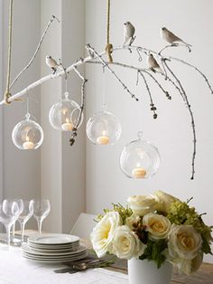 Nature Crafts for Your Winter Table BHG.com hanging white tree branch with birds, and hanging lights