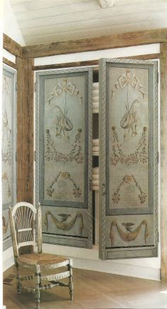 Dressing room...decorative painted French doors to conceal linens