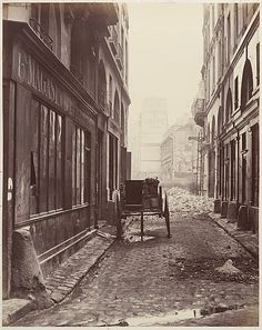 "Charles Marville, (French, 1813–1879). Rue Estienne from the rue Boucher (First Arrondissement),1862–65. The Metropolitan Museum of Art, New York. Gilman Collection, Purchase, Mr. and Mrs. Henry R. Kravis Gift, 2005 (2005.100.358) | This photograph is featured in ""Charles Marville: Photographer of Paris,"" on view through May 4, 2014. #paris"