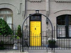 yellow door...grey brick