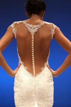 Check out the pearl buttons on the back of this Berta wedding dress! (Photo: Robert Mitra)