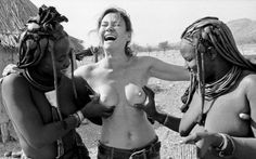 Photographer Sasha Gusov photographs his wife Husova interacting with native women on a trip in Namibia in 2003
