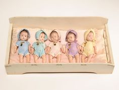 Madame Alexander Dionne Quintuplets five cute little composition baby dolls in their crib.