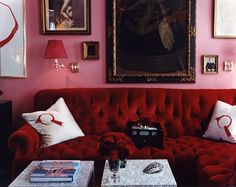 Red couch and pink walls