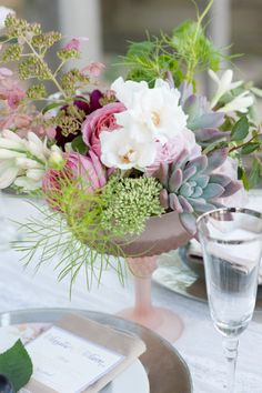 This gorgeous centerpiece is perfect for and earthy elegant wedding. #centerpiece #weddingreception #weddingchicks Design By: Naturally Yours Events http://naturallyyoursevents.com/