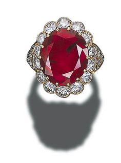 A VERY IMPORTANT RUBY AND DIAMOND CLUSTER RING, BY VAN CLEEF & ARPELS   Set with an oval-cut ruby in a circular-cut diamond surround to the pavé-set diamond shoulders and 18K gold hoop. From the Gubelin Gemmological Laboratory stating that the ruby weighs approximately 14.01 carats, is of Burmese origin and shows no indications of thermal treatment van cleef, diamond cluster