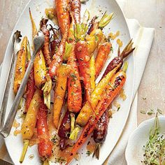 Honey-Roasted Carrots | Substitute apple juice for bourbon, if you prefer. Look for bunches of carrots that are all about the same size so they'll cook evenly. | SouthernLiving.com
