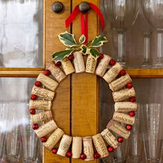Pop Out the Cork  	    Add pop to a dining room with wine corks wired to tiny red jingle bells. Take about 22 corks of the same size and 22 small (3/8 of an inch) red bells bought from a crafts store. Drill a small hole (just big enough to fit your wire through) 1/4 of an inch from the top of each cork and another 1/4 of an inch from the bottom. It is very important to make sure all the drilled holes at the top line up with the holes at the bottom. Using long, green floral wire, push the wire ...