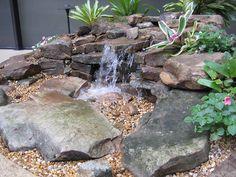 Pondless backyard waterfall