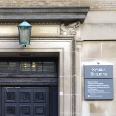 10/11/14 -- Sparks Building detail shows the side entry, dark door, sculptural elements and copper lamp.