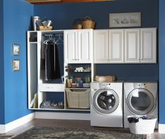 Beautiful blue walls really make the white cabinets and appliances pop