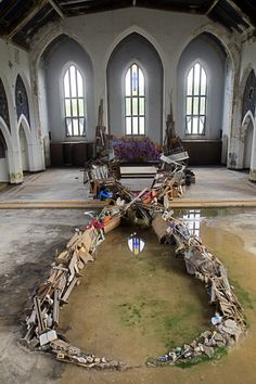 A mysterious art installation found inside the abandoned Woods Cathedral Church of God in Christ in Detroit--the church has been abandoned since 2005, and no one knows who assembled this.