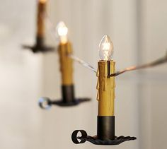 Ohhhhh My!!!!!! I want these for my primitive x-mas tree! Floating Candle String Lights #potterybarn