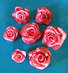 Gum paste roses painted using similar, yet slightly different, methods. There's more than one way to make 'em shiny.