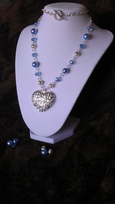 $18 Starting Bid: Iced Heart Crystal & Glass Pearl Necklace (you choose color). http://www.outbid.com/auctions/1571#22