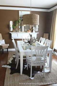 Pretty dining space done in neutrals burlap, animals, dwell, dine room, devor, chairs, mantel, lamp, pendant lights
