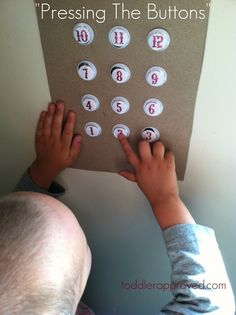 Homemade elevator buttons for play and math learning. A fun way to teach about number recognition.