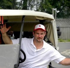 Hockey Coach in Golf Cart Basleep Photos