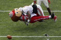 Ouch! The moment Ohio State linebacker flattened mascot Brutus the Buckeye