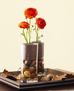 Add Thanksgiving flavor to a tabletop or mantel with cylinder vases filled with nuts, flowers and coordinating scrapbook paper. More ideas: http://www.midwestliving.com/holidays/thanksgiving/easy-ideas-for-thanksgiving-decorating/?page=10,0