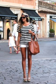 black and white strip tee, white shorts & tan bag