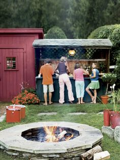 Adding a fire pit is one way to create an outdoor kitchen. A bar ups the ante on dining and a place for food.