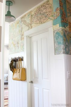 Map wallpaper- great for accent wall or small space above wainscoting. This is push-pinned but removable wallpaper paste would work great too!