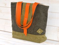 Amy Vintage Wool Tote bag / French Shoulder Bag / Green and black,green,gray with Hermes orange leather strap. $102.74, via Etsy.
