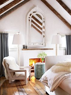 White Scandinavian Bedroom With Fireplace and Sheepskin Throw