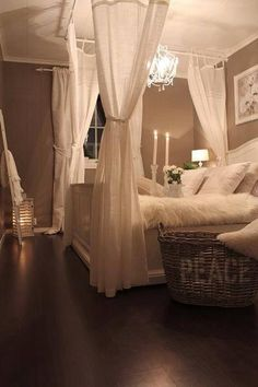 Nice contrast of dark floors, white linens and taupe/neutral wall. Chandelier adds warmth and elegance   repinned by PeachSkinSheets.com