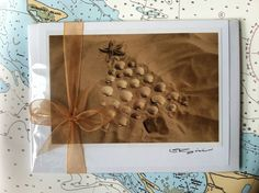 Holiday Series I from The Coastal Collection consists of six hand-crafted, assorted coastal holiday cards and envelopes. Wrapped in a clear sleeve and adorned with a gold organza bow.  https://www.etsy.com/listing/160820491/holiday-series-i-card-set-by-the-coastal?ref=related-4