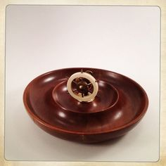 vintage nutcracker wooden serving dish brass bakelite ship's wheel. via Etsy.