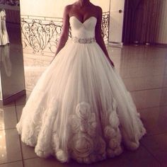 I like the neckline/bodice and silhouette but not the designs on the skirt