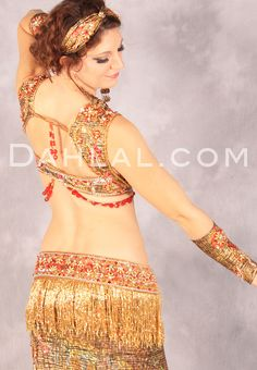 http://www.dahlal.com/everlasting-elegance-in-gold-and-red-by-designer-pharaonics-of-egypt-egyptian-belly-dance-costume/