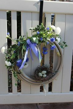 Craft this adorable spring wreath from a worn-out garden hose.