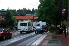 On the road to Rocky Mountain National Park.  A Bigfoot travel trailer and a Wildcat fifth wheel trailer in Estes Park town center traffic, September 4, 2009.